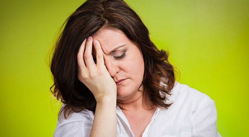Middle aged woman suffering from stress