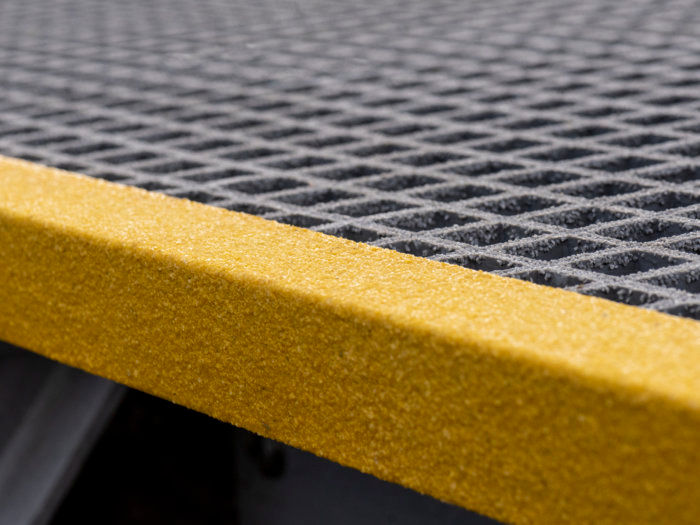 Yellow GRP Stair Nosing on Grating