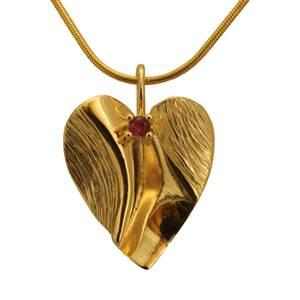 Unikt guldhjerte med rubin