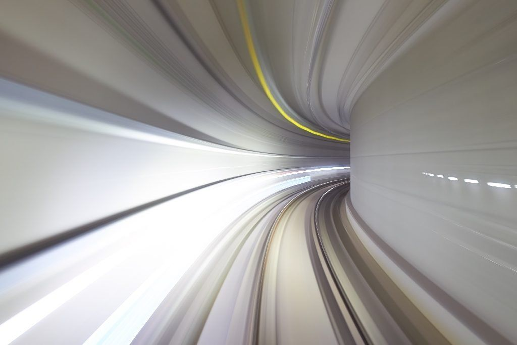 A tunnel in time lapse curving around a corner
