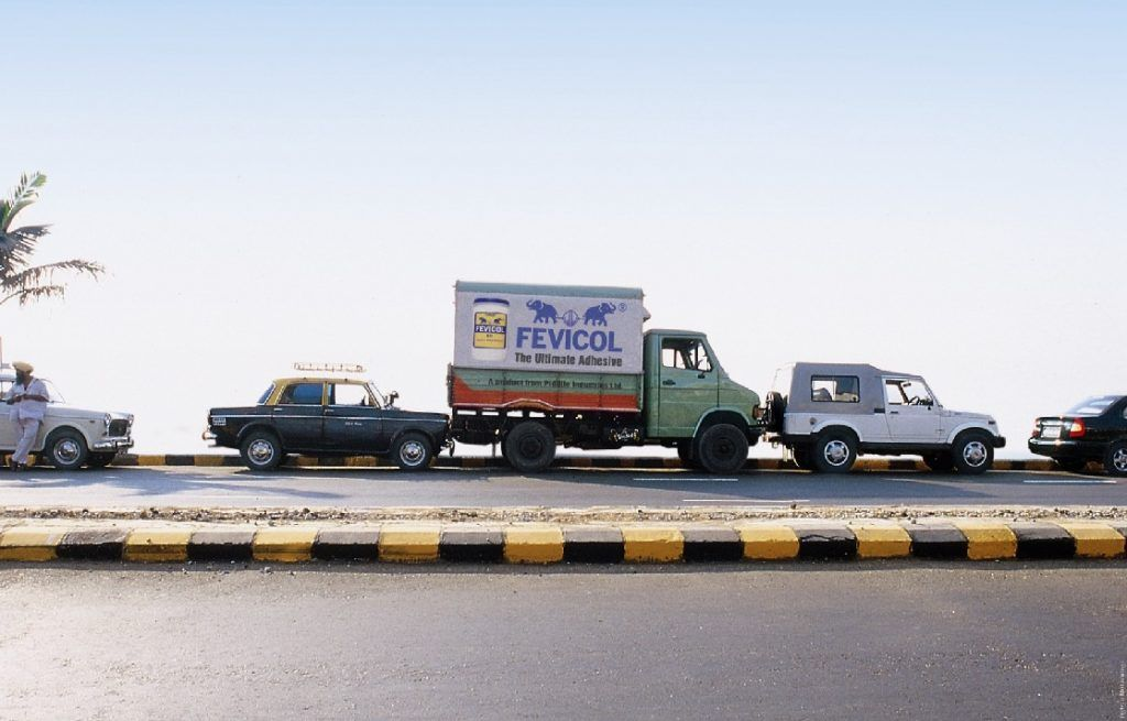 A poster for Fevicol showing a truck wedged between a taxi and a jeep