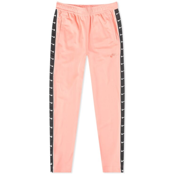 Nike Taped Poly Trackpants in Pink