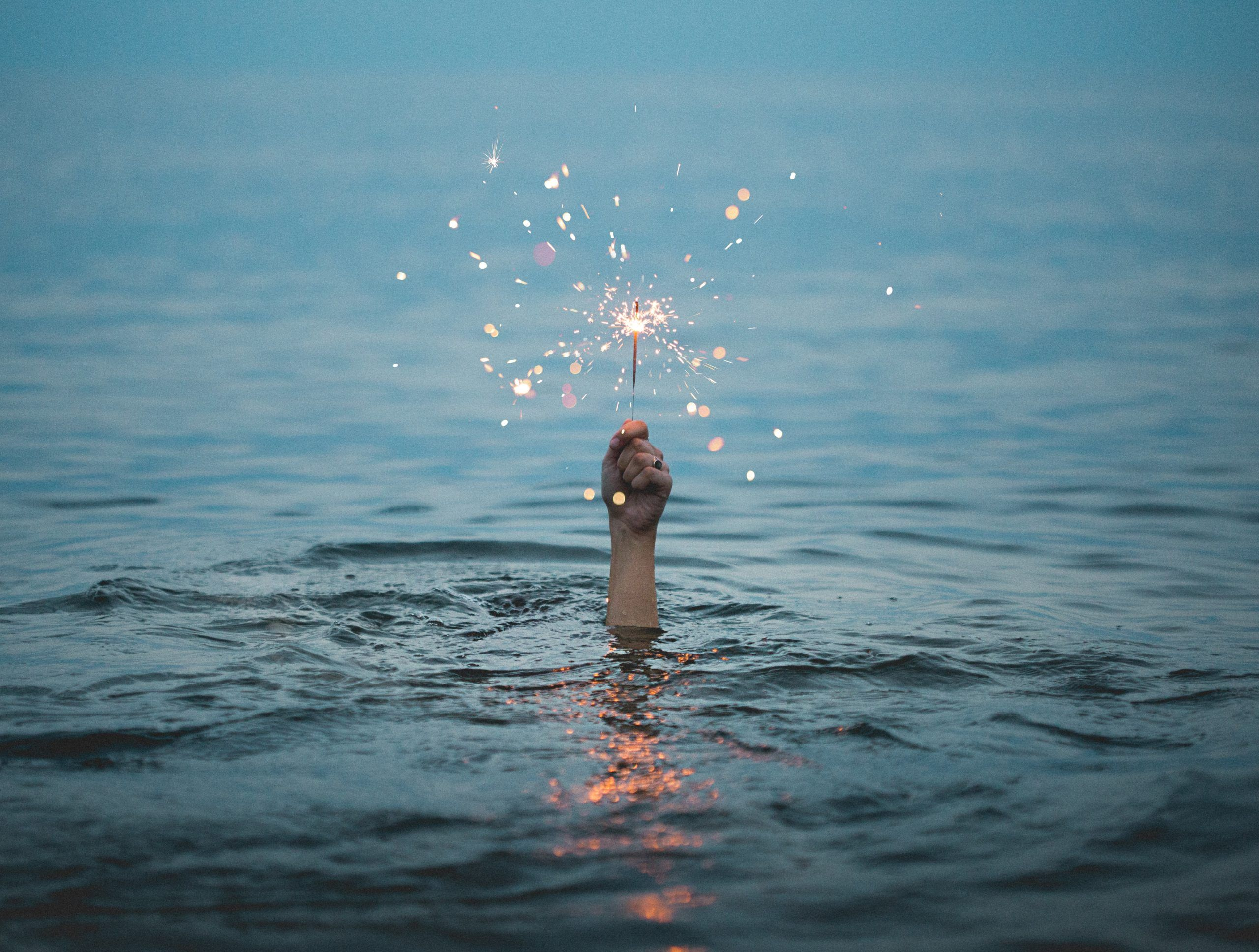 Hand with wand in water