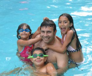 Image for link to Family swimming
