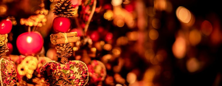 Red and gold Christmas decorations against a blurred background