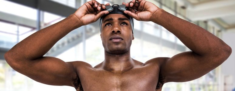 Swimmer adjusting goggles