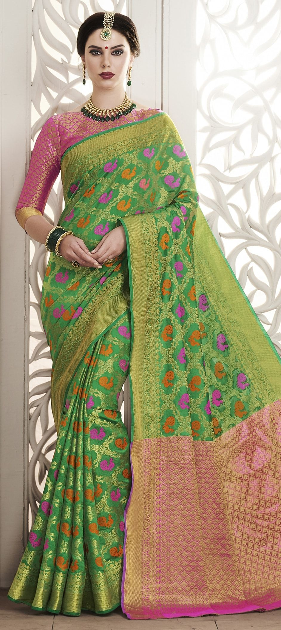 3612a39f8244b3 774913  Green color family Silk Sarees with matching unstitched blouse.
