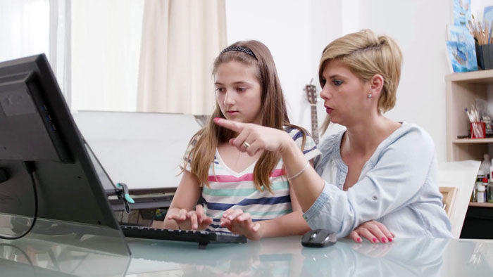 Mother and daughter home schooling
