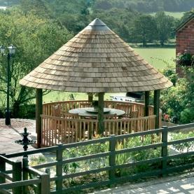 Colonial Breeze House with cedar shingle roof