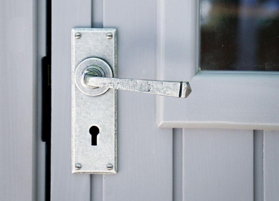 Pewter door handle of the Kew Darwin by Malvern Garden Buildings