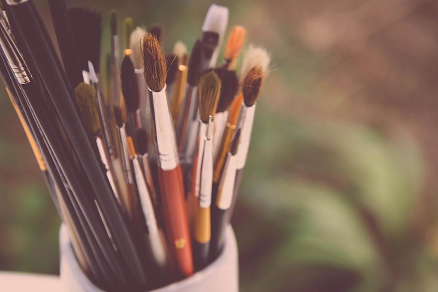 Paint bruches inside a paint pot