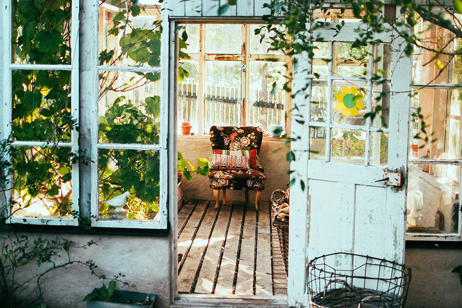 Rustic Greenhouse with an arm chair inside