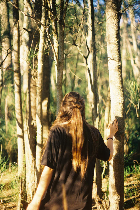 Lady walking through a forest