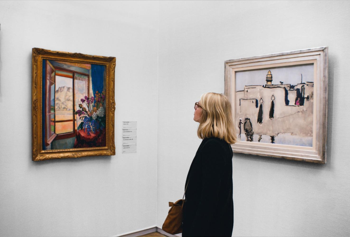 Blonde woman looking at an art exhibition. Staycation Inspiration for Leek, Staffordshire