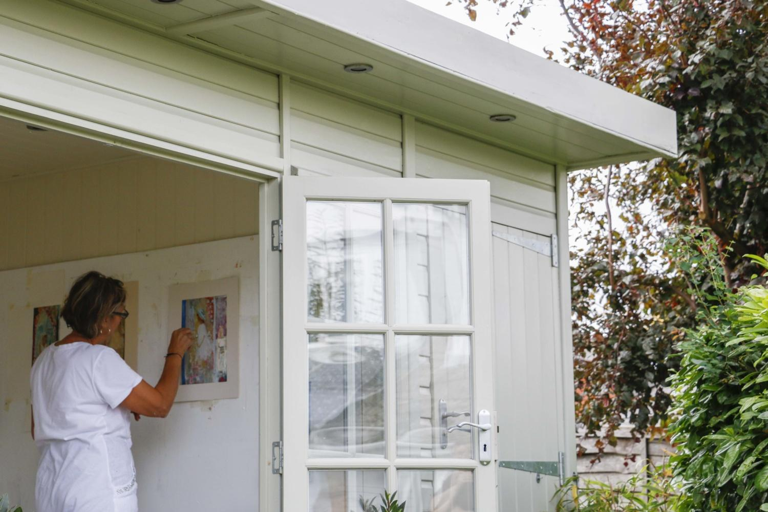 Sally-Anne uses her ShofficePlus as her artist's studio. Situated at the end of the garden, her retreat can be enjoyed by the whole family whilst she paints. Read her case study on Garden Escape by Malvern Garden Buildings.