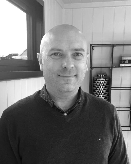 A black and white headshot of David who is smiling. David works as part of our sales team at our Buckinghamshire showsite