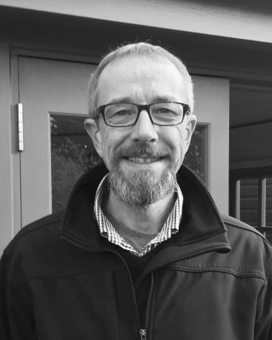 A black and white headshot of Derrick who is smiling. Derrick works as part of our sales team at our Wiltshire showsite
