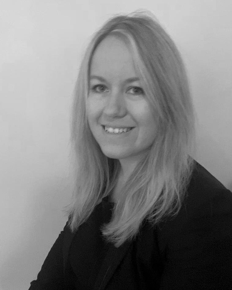 A black and white headshot of Jenny who is smiling. Jenny works as part of our sales team at our Greater London showsite