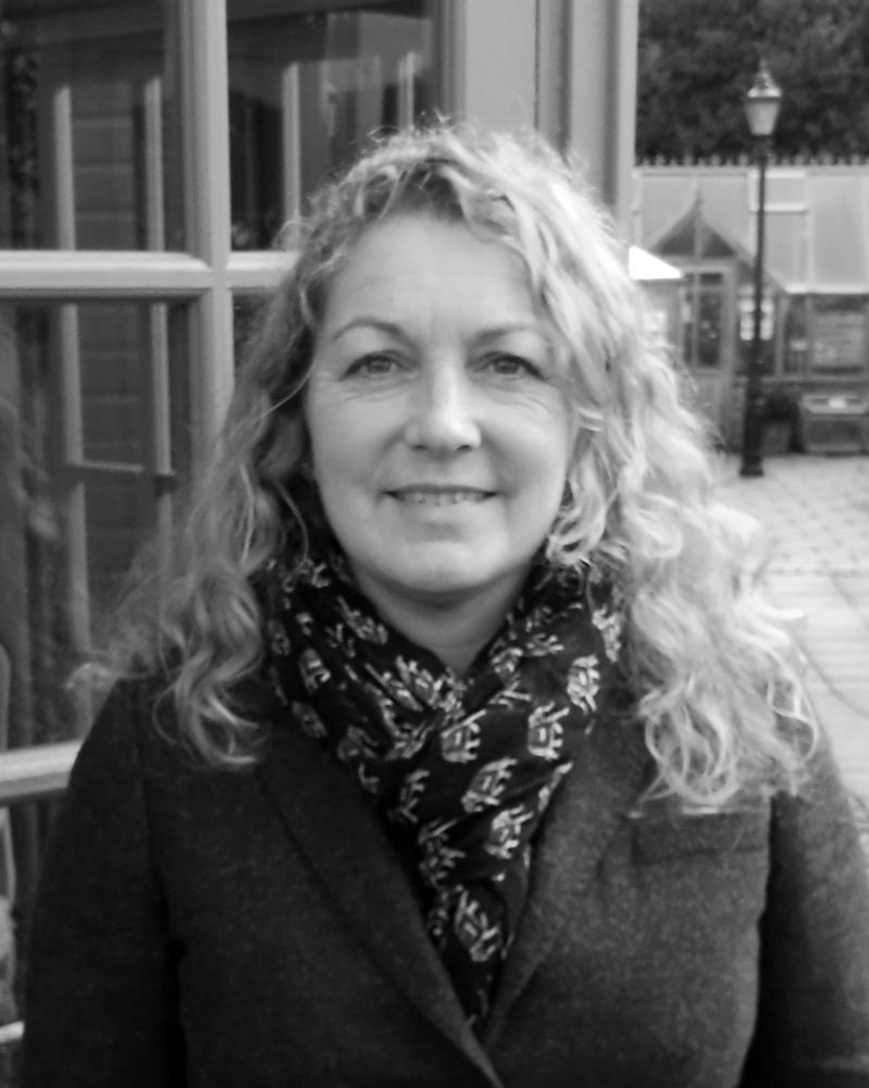 A black and white headshot of Lisa who is smiling. Lisa works as part of our sales team at our Wiltshire showsite