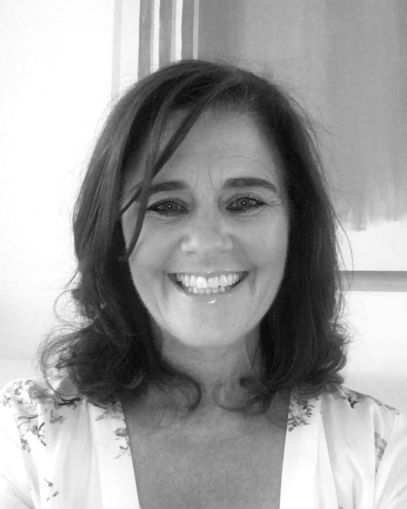 A black and white headshot of Majella who is smiling. Majella works as part of our sales team at our Greater London showsite