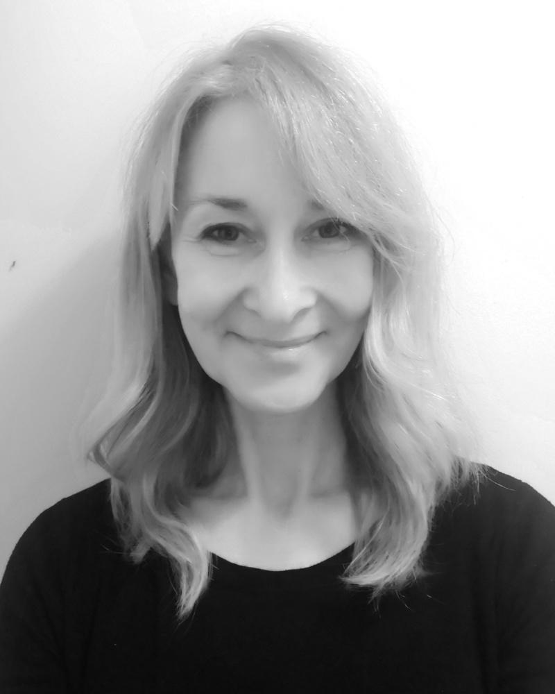 A black and white headshot of Cathy who is smiling. Cathy works as part of our sales team at our Cheltenham showsite