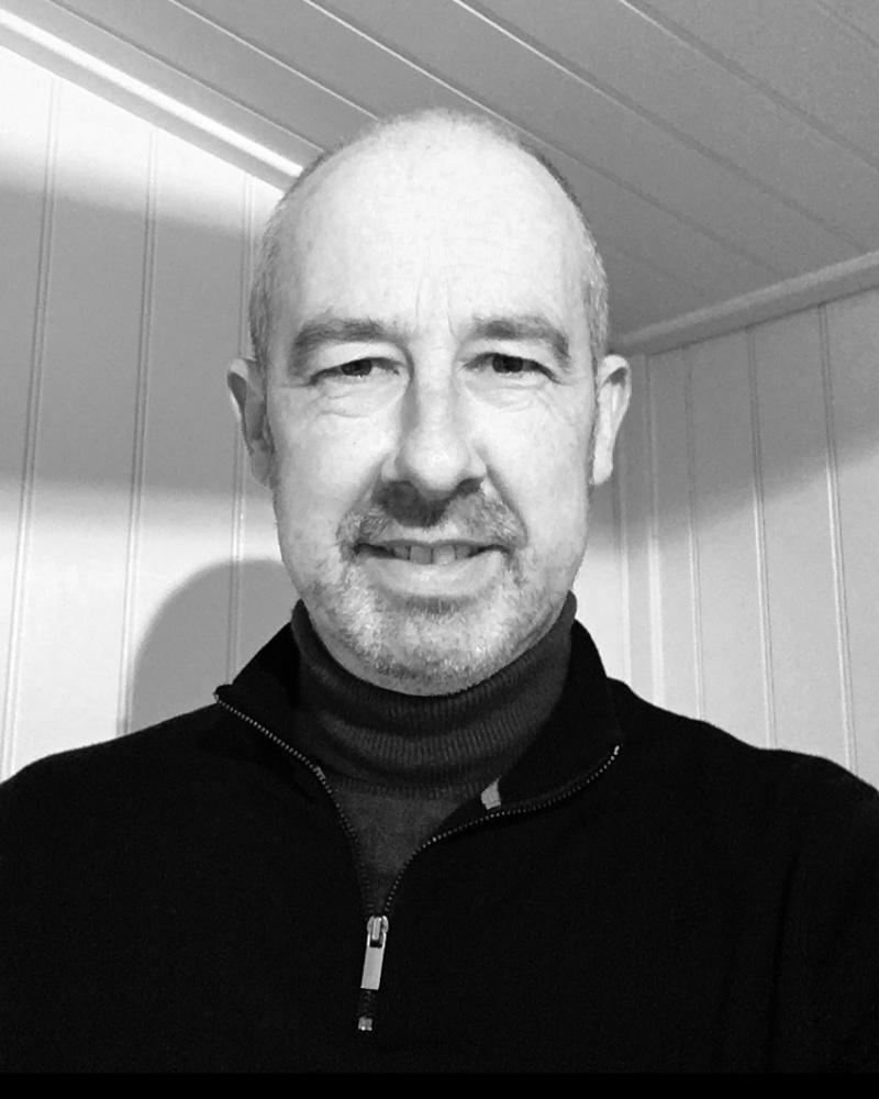 A black and white headshot of Simon who is smiling. Simon works as part of our sales team at our Nottingham showsite