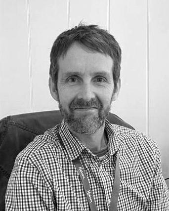 A black and white headshot of Simon. Simon works as part of our sales team at our Brighton showsite