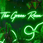 green neon LED light reads 'The Green Room'