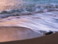 Golven en lage sluiters te Wringcliff Bay. © Sandy Spaenhoven