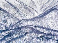 Een besneeuwde vallei. © Jeffrey Van Daele