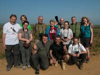 Een groepsfoto in Merja Zerga, net na het zien van Afrikaanse velduil. © Billy Herman