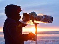 Sfeerbeeld fotograaf bij zonsondergang. © Yves Adams