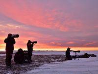 Fotografen bij zonsondergang. © Yves Adams