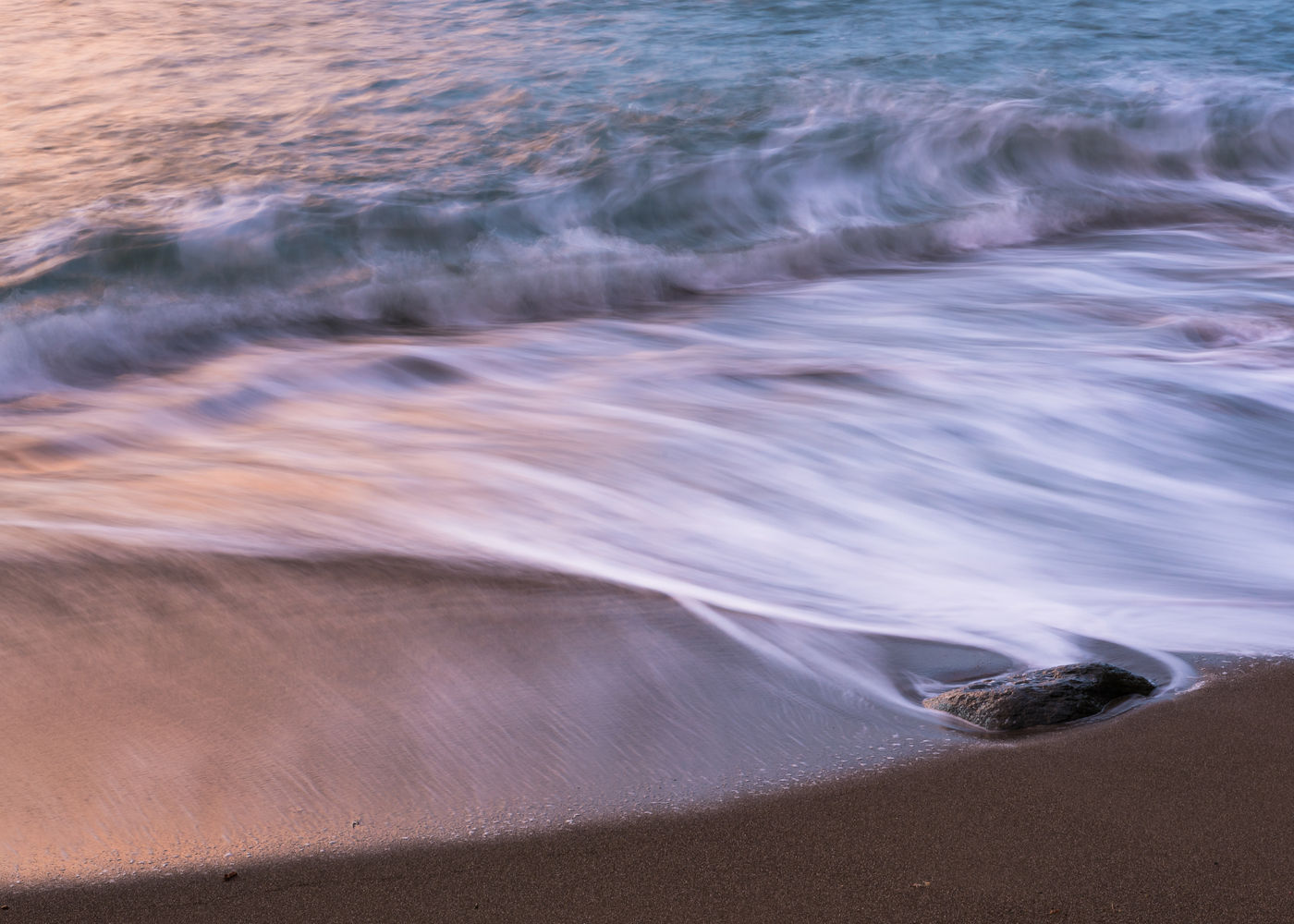 Golven en lange sluitertijd, Wringcliff Bay. © Sandy Spaenhoven