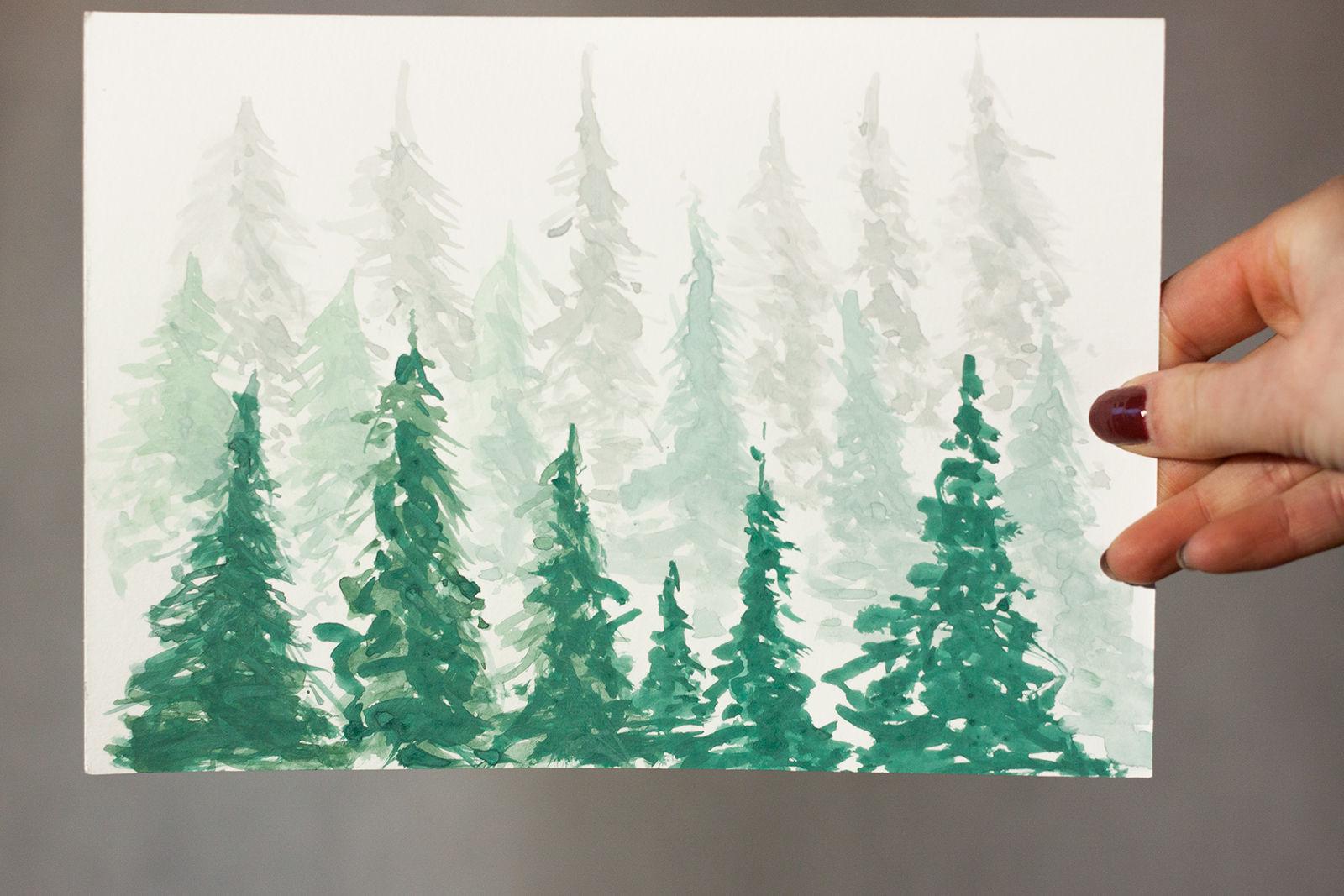 las iglasty malowany akwarelami, trzymane w ręce na szarym tle