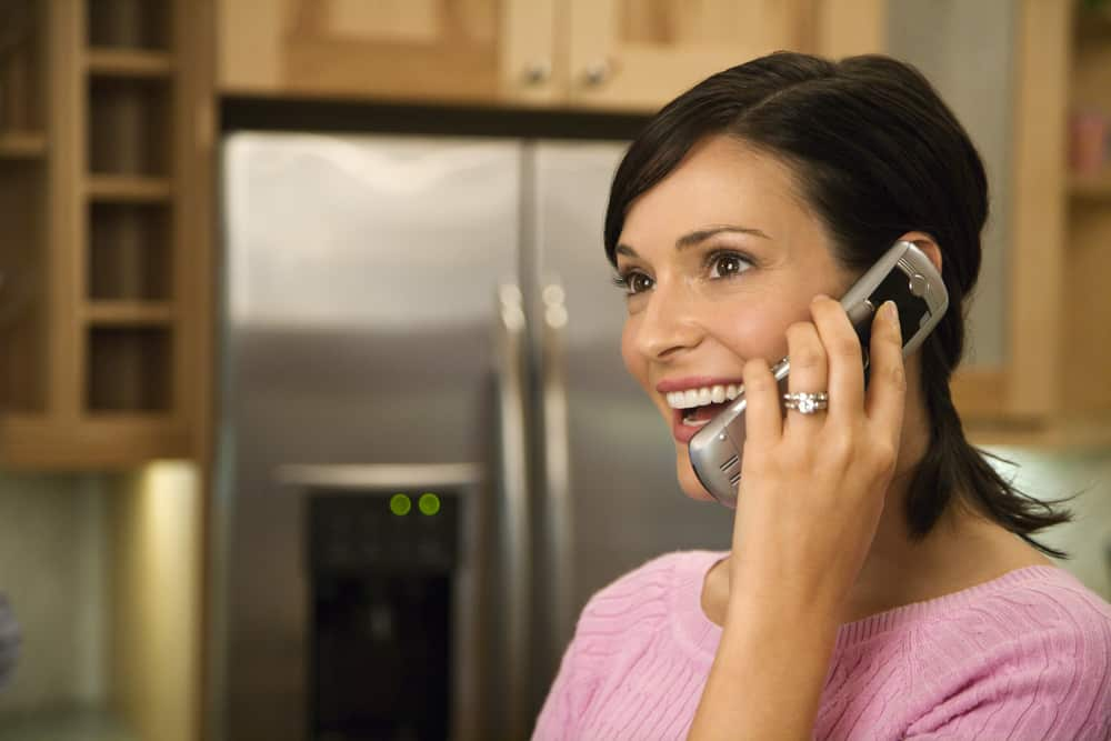 Virtual Meeting-Woman on Phone in kitchen