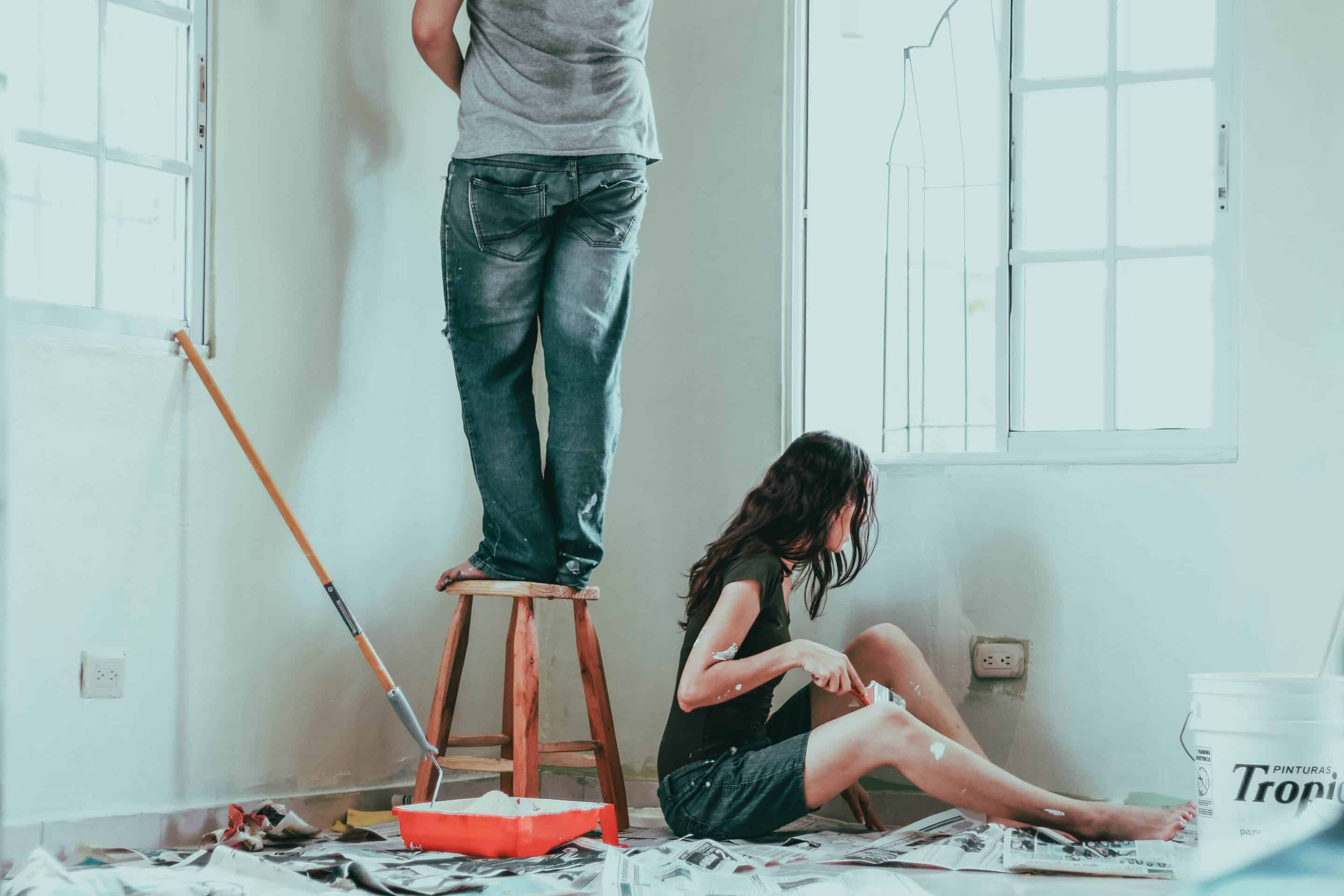 A couple DIYing a home paint job