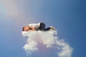 Girl sleeping on a cloud in the sky