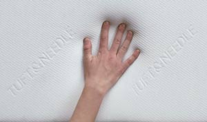 hand touching fabric on foam