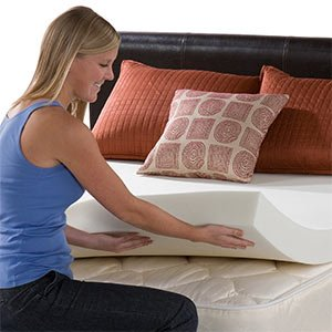 girl placing a memory foam mattress topper