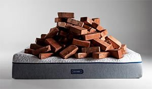 the novosbed mattress with a pile of bricks