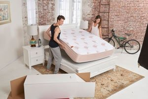 happy couple setting up the pangeabed mattress