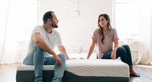 couple chatting on the voila mattress