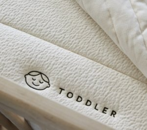 View of the Avocado Green Luxury Organic Crib Mattress toddler side