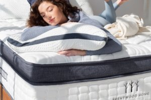 A lady resting on the the Brentwood Home Oceano Luxury Hybrid mattress