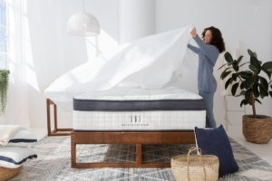 A lady setting the sheets on the Brentwood Oceano