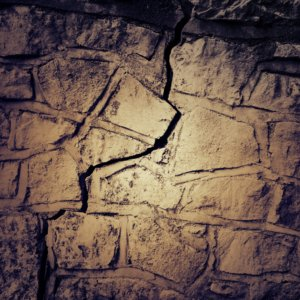 Stone wall with a crack jagging through
