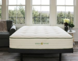 The Green Thyme mattress in a room with big windows