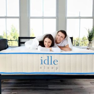 The IDLE All natural latex mattress with two people on it