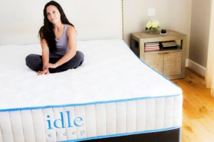 View of the IDLE Mattress with a woman on it
